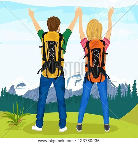 happy young couple of hikers standing on top of mountain and enjoying nature scenery
