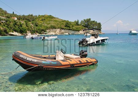 PAXOS, GREECE - JUNE 11, 2014: Small boats moored in the harbour at Loggos on the Greek island of Paxos. The village is the third main area of population on the island.