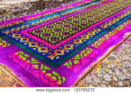 Antigua Guatemala - March 24 2016: Handmade dyed sawdust Holy Thursday carpet for procession in colonial town with most famous Holy Week celebrations in Latin America.