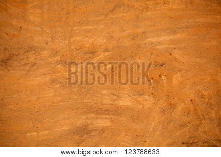 Brown clay mortar on a wall as texture or background.