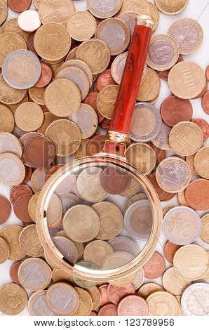Business Money Concept Idea, Coins and Loupe Magnify Glass