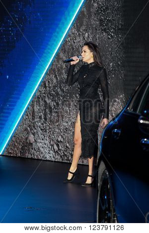 NEW YORK - March 23: Performer Grace Capristo singing during Daimler AG Mercedes-Benz press conference the 2016 New York International Auto Show in New York  exhibit at Press day 2016 in New York, NY.
