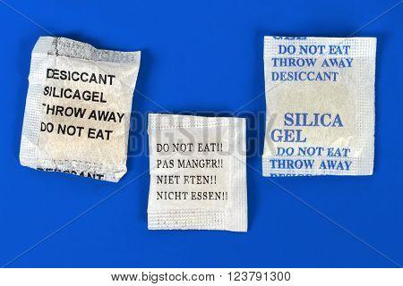 Macro of silica gel bags on blue background