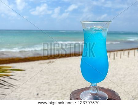 Picture of a blue cocktail drink,taken on a beach at the Mexican Riviera.