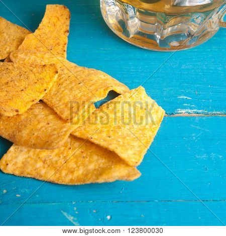 Corn Chips And A Mug Of Beer On The Table