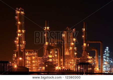 Closeup Of Petrochemical Oil Refinery Factory At Night