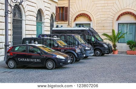 Rome, Italy - June 25, 2014: Different size police cars parked in a quiet courtyard in the center of the Italian Rome. Police Car in italian capital Rome.