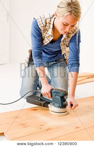 Home Improvement - Handywoman Sanding Wooden Floor
