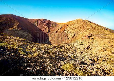Volcanic landscape in Tmanfaya national park on Lanzarote island in Spain