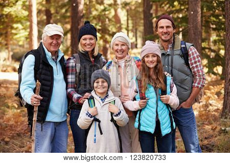 Multi generation family on hike in forest, group portrait