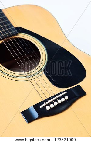Acoustic guitar on white background, stock photo
