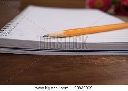 Notebooks and pensil on wooden background camelia ** Note: Soft Focus at 100%, best at smaller sizes