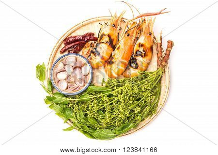 Exquisite thai dining; grilled river prawns served with neem and sweet fish sauce serving on weave threshing basket