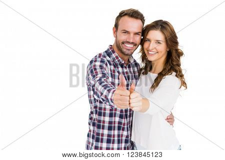 Portrait of happy young couple putting thumbs up on white background