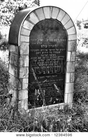 A monument commemorating the Jews. Gravestones in the old 400-year-old Jewish cemetery in Ozarow. Poland