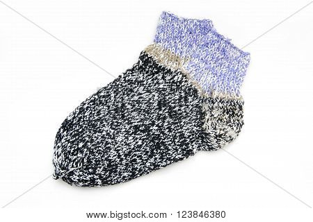nitted wool socks on a white background