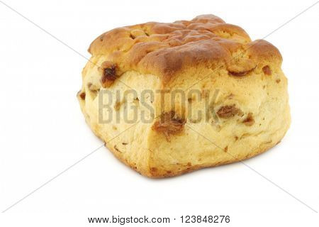 traditional english scone with raisins on a white background