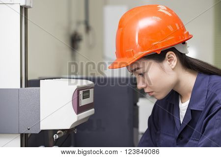 young woman engineer setup testing machine in the factory