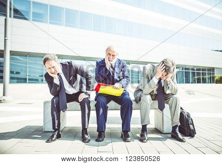 Financial crisis three desperate businessmen after dismissal - Concepts about crisis job and bankruptcy