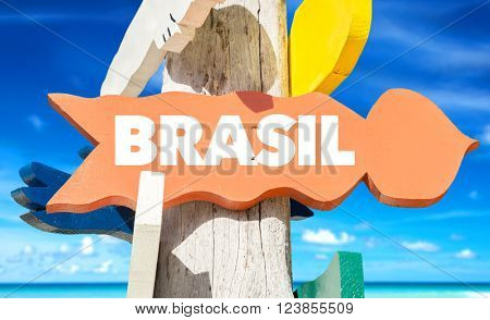 Brazil (in Portuguese) signpost with beach background