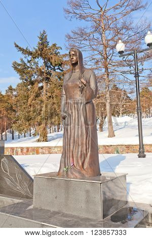 YUZHNO-SAKHALINSK RUSSIA - MARCH 17 2016: Statue Grieving Mother part of the memorial (circa 2004) for Russian soldiers killed in Afghanistan and Chechnya conflicts. Sculptor Vladimir Chebotarev