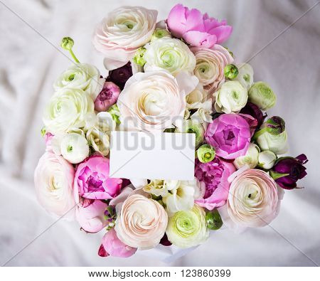 Top View Of Beautiful Bunch Of Summer Flowers With Blank Card Over White