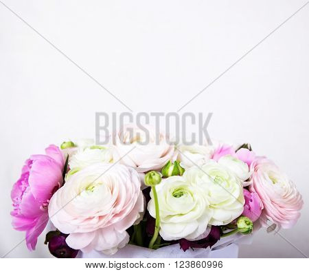 close up of beautiful bunch of summer flowers over white