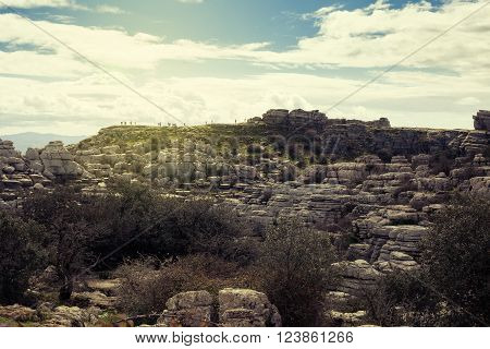 View Of Karst Rocks In El Torcal, With Visitors In The Background, Antequera. Spain.