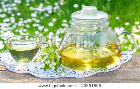 Jasmine tea Jasmine flowers on the garden table