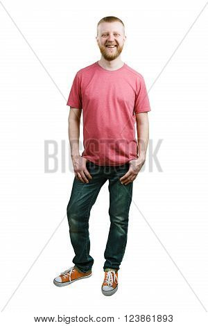Bearded young man in a T-shirt and blue jeans