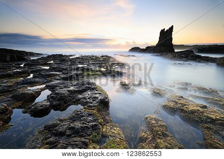 Cathedral Rock in Kiama south coast NSW has a definite resemblance to a cathedral or church. Long exposure calms the waves creating a surreal place.  A rock pile ceases to be a rock pile the moment a single man contemplates it bearing within him the imag