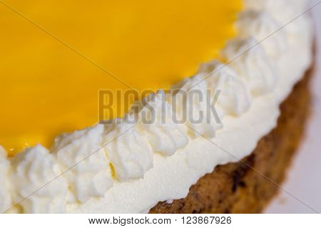 Advocaat cake on wood macro picture background