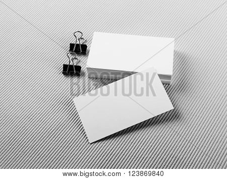 Photo of blank business cards with soft shadows on gray background. For design presentations and portfolios. Mock-up for branding identity.