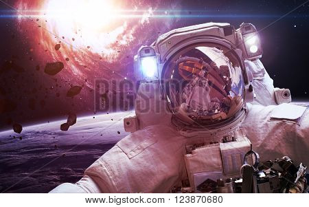 Astronaut in outer space. Spacewalk. Elements of this image furnished by NASA poster
