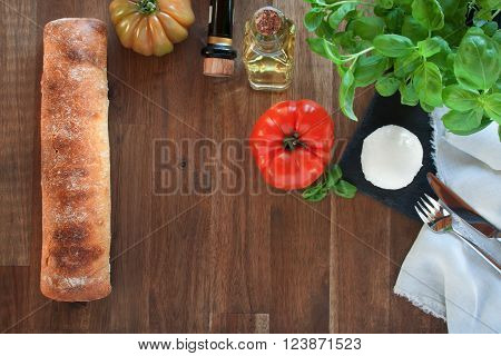 Ciabatta with tomatoes mozzarella basil olive oil and balsamic