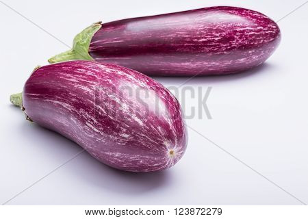 two striped eggplants, aubergines, on white background