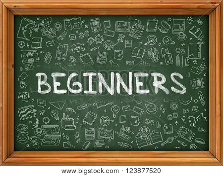 Beginners - Handwritten Inscription by Chalk on Green Chalkboard with Doodle Icons Around. Modern Style with Doodle Design Icons. Beginners on Background of  Green Chalkboard with Wood Border