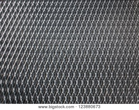 Shiny galvanised industrial steel grid for use as background.