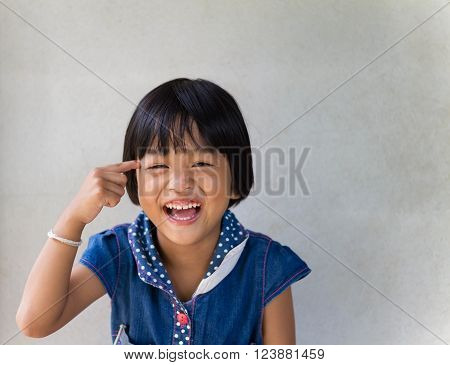 Portrait of asian little girl smiling at thai