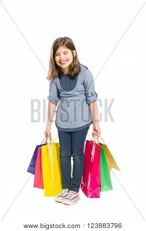 Happy and young shopping girl laughing isolated on white background