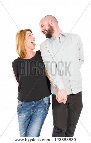 Crazy and funny young couple in love posing on white background