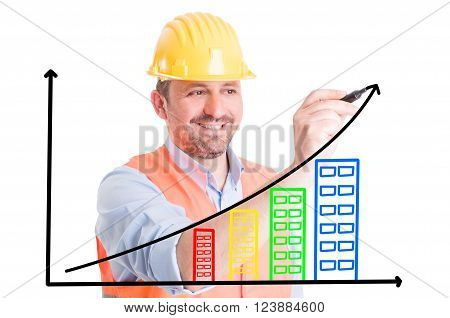 Builder drawing growing chart with buildings on transparent screen or wipe board