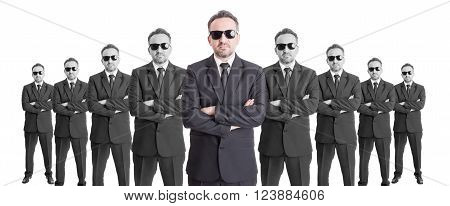 Team of confindent business people or special agents with arms crossed on wide image. Leader concept