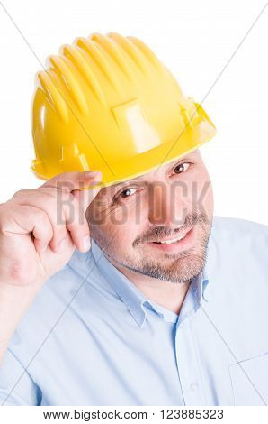 Polite engineer or architect touching helmet as salutation poster