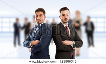 Business people back to back standing confident as competitors or partners