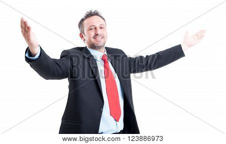 Business Man With Open Arms Looking Into The Camera