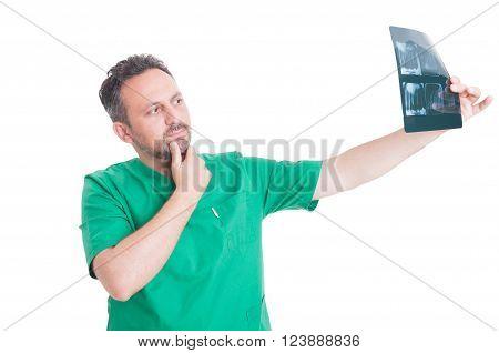 Male Dentist Analyzing Denture Xray