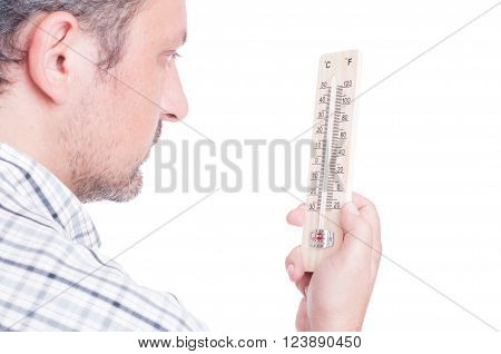 Man holding thermometer and checking temperature isolated on white