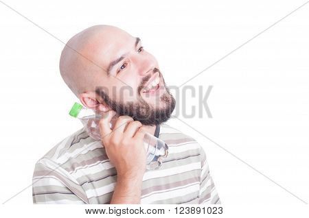 Smiling Man Cooling Neck With Cold Water In Plastic Bottle