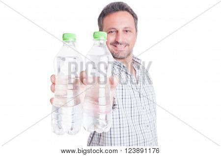 Man offering bottles of cold water as summer dehydration and hydration concept isolated on white